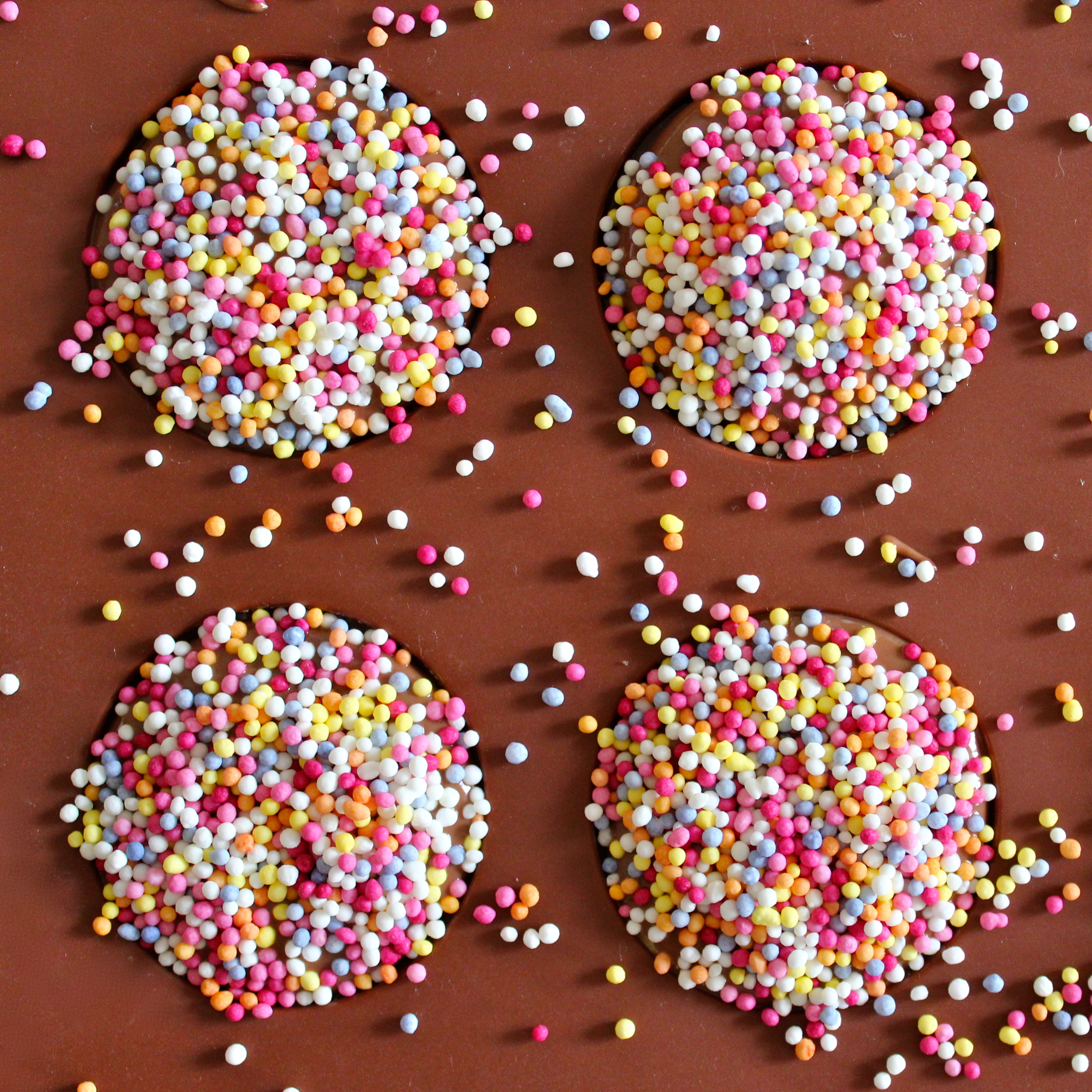 sprinkle the still gooey chocolate liberally with your candy sprinkles