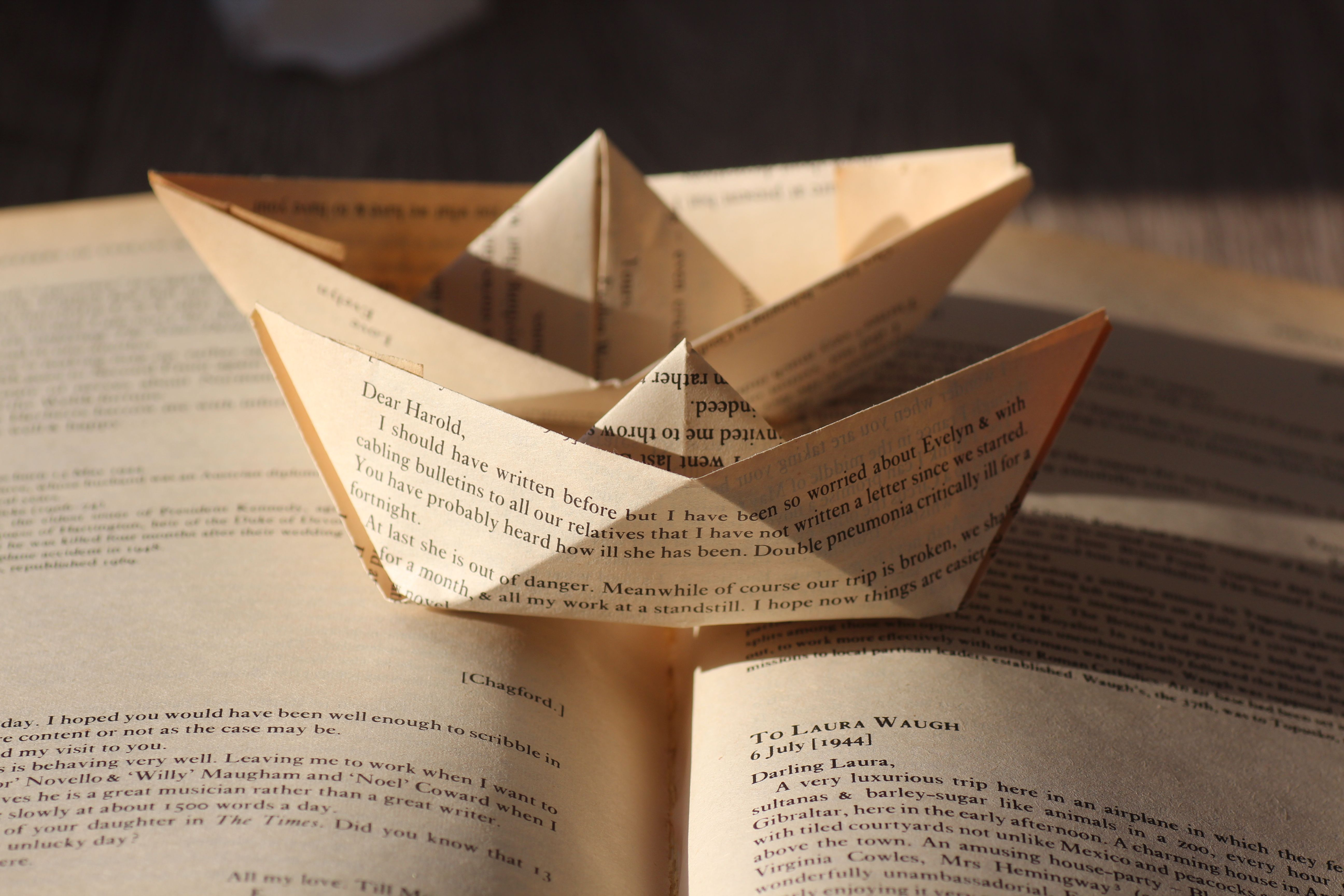 paper boats made from old book pages