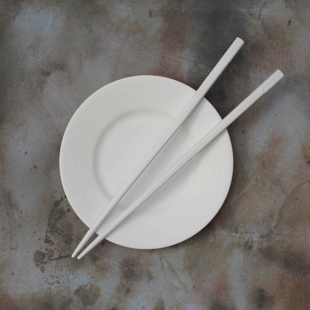 sprayed white chopsticks on saucer
