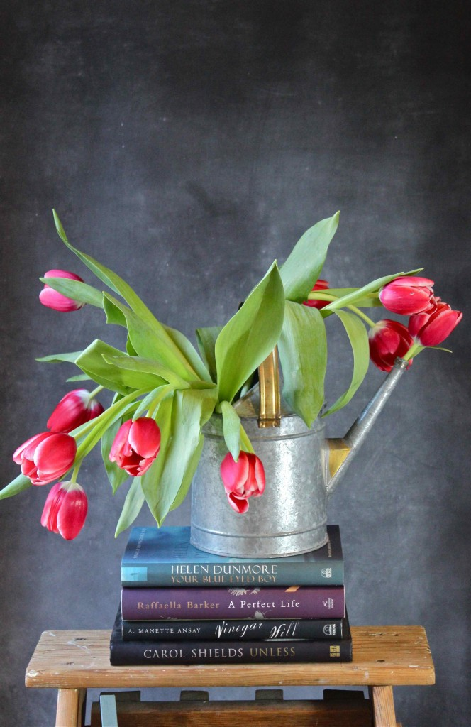 tulips in watering can