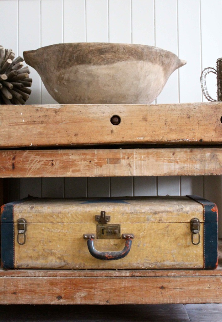 Butchers block with old suitcase and dough bowl