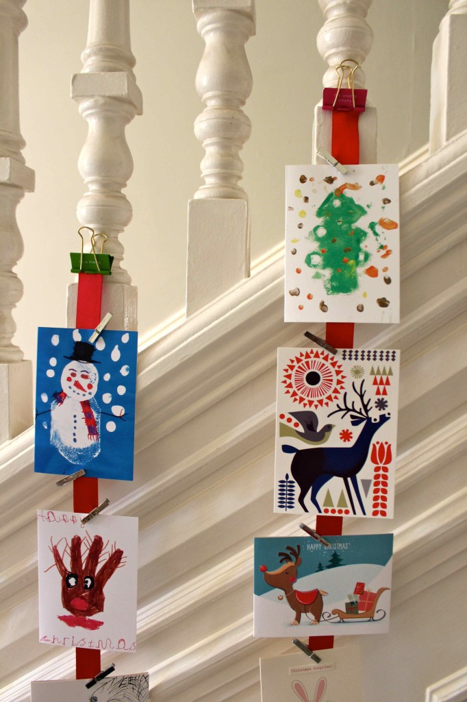Christmas cards hanging in the hallway
