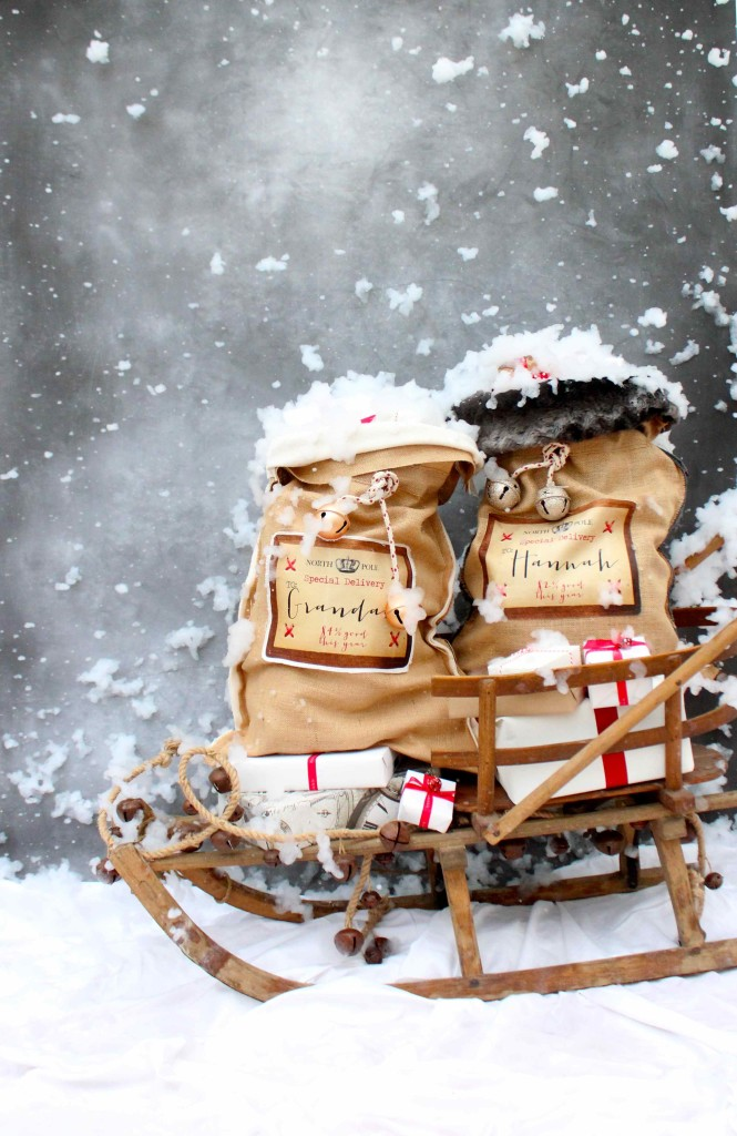 Personalised santa sacks on a sleigh